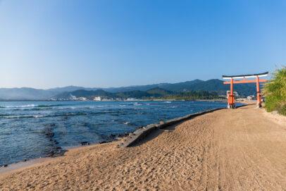 Torii gate besides the ocean